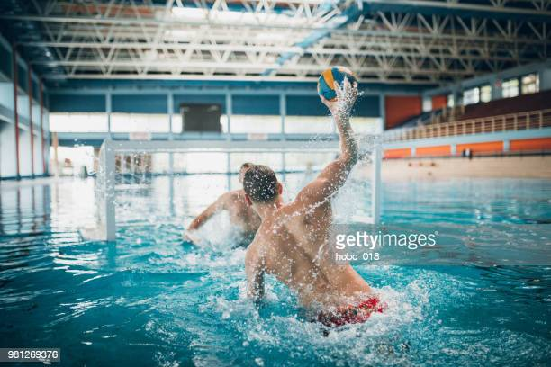 strong water polo shoot - water polo stock pictures, royalty-free photos & images