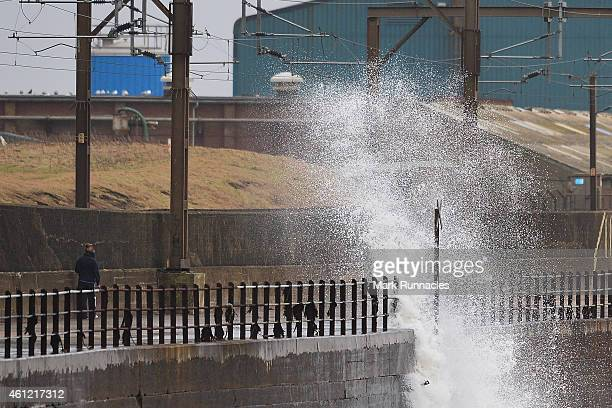 Strong waves begin to build along the sea defences as high tide approaches during a storm on January 9, 2015 in Ardrossan Scotland. A vigorous...