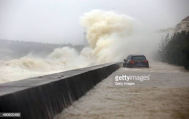 Strong waves brought by Typhoon Dujuan hit breakwater on September 29, 2015 in Quanzhou, China. Typhoon Dujuan made landfall in the coastal city of...