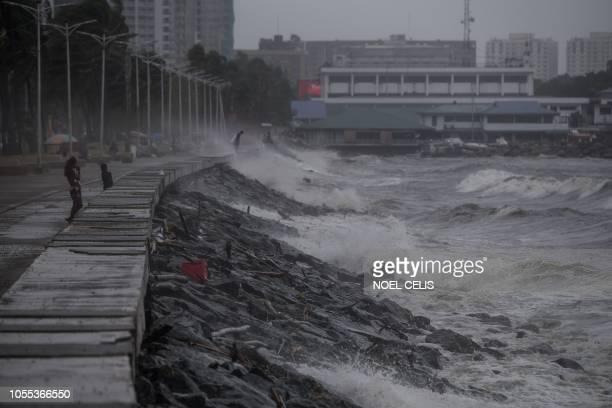 Strong waves pound the waterfront as weather patterns from Typhoon Yutu affect Manila Bay on October 30 2018 Typhoon Yutu slammed into the...