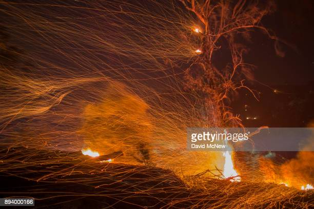 A strong wind blows embers at the Thomas Fire on December 16 2017 in Montecito California The National Weather Service has issued red flag warnings...