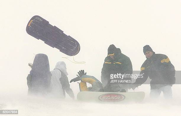 Strong wind gusts of over 40mph made it hard for Aurora Illinois residents to hold onto their sleds 22 January after 10 inches of snow fell in the...