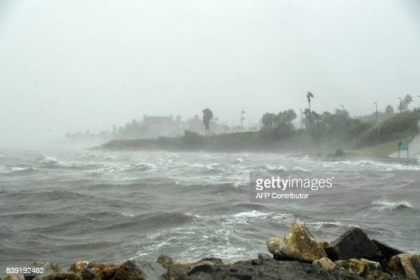 TOPSHOT Strong winds batter seaside houses before the approaching Hurricane Harvey in Corpus Christi Texas on August 25 2017 Hurricane Harvey will...