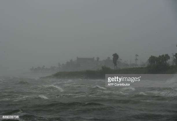 Strong winds batter seaside houses in Corpus Christi Texas on August 25 as Hurricane Harvey approaches Harvey has intensified into a powerful...
