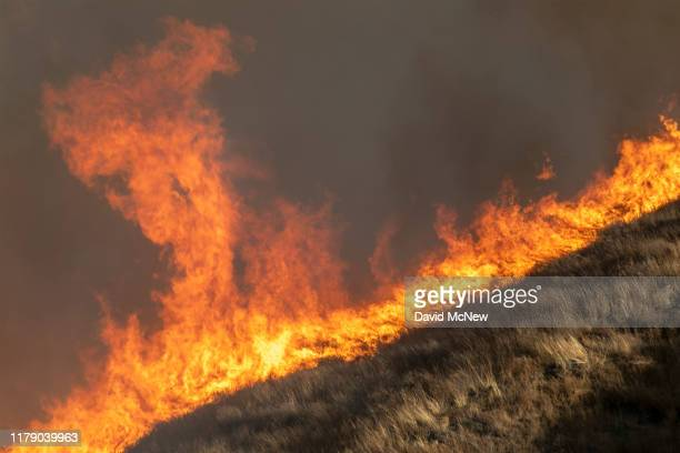 Strong winds drive the Easy Fire on October 30 2019 near Simi Valley California The National Weather Service issued a rare extreme red flag warning...