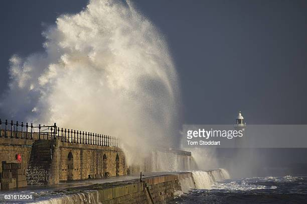 Strong winds send high waves crashing over Tynemouth Pier during high tide on January 13 2017 in Tynemouth United Kingdom Strong northerly winds...