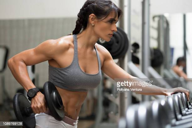 strong woman bodybuilder - sexy figures stock pictures, royalty-free photos & images
