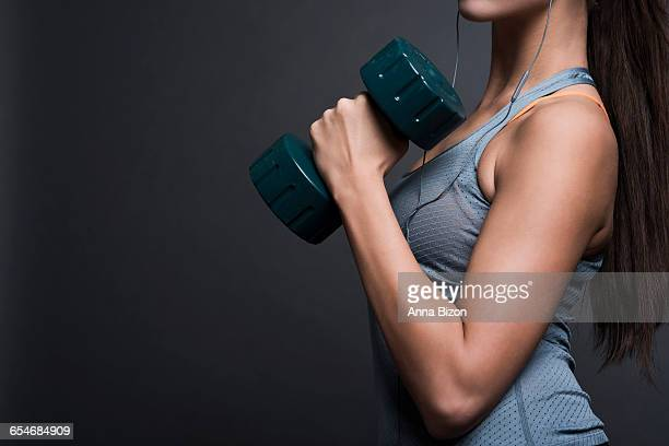 Strong woman carrying heavy dumbbell. Debica, Poland