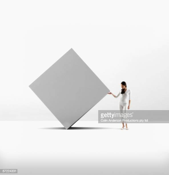 Strong woman looking under large object