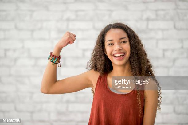strong woman - flexing muscles stock pictures, royalty-free photos & images