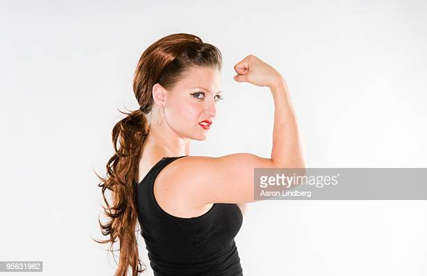 Strong woman posing