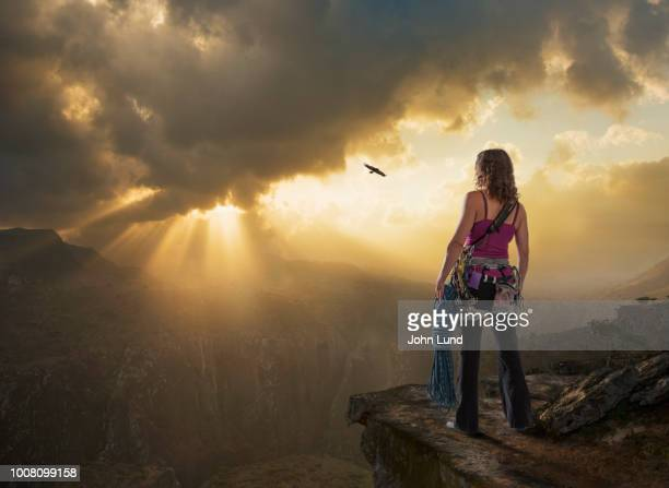 strong woman rock climber on edge of cliff - john lund stock pictures, royalty-free photos & images