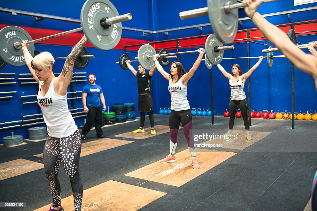strong woman weightlifting on a gym La Mole gym : Stock Photo