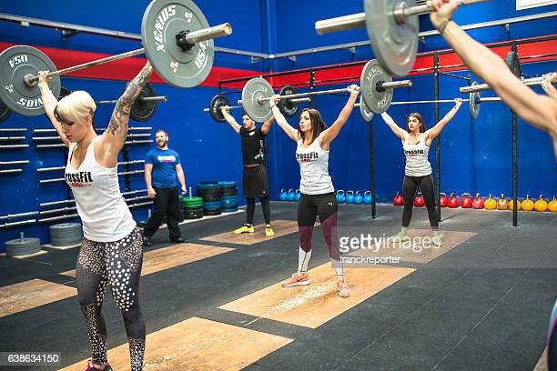 strong woman weightlifting on a gym la mole gym - snatch weightlifting stock photos and pictures