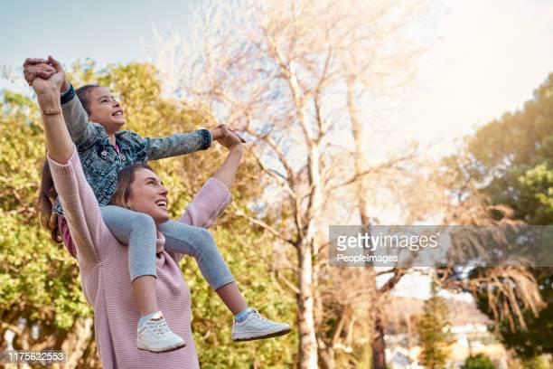 strong women raise strong daughters - stepfamily stock photos and pictures