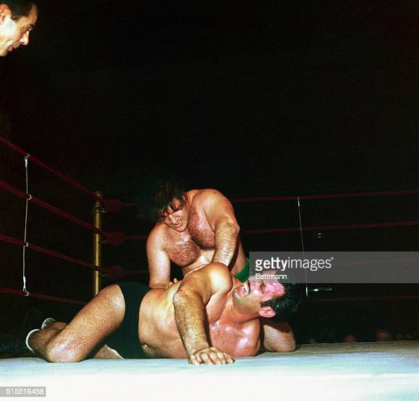 Strong-boy Bruno Sammasrtino, of Abruzzi, Italy, downs Michele Scicluma, of Malta, during their match at Madison square garden here January 24....