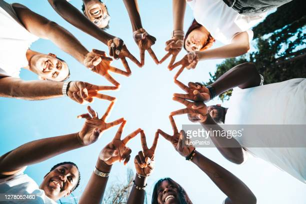 stronger together - altruism stock pictures, royalty-free photos & images