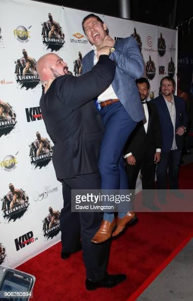 Strongman Brian Shaw and actor Alain Moussi attend the premiere of Well Go USA Entertainment's 'Kickboxer Retaliation' at ArcLight Cinemas on January...