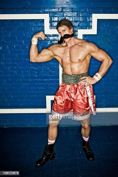 Strongman flexes muscles
