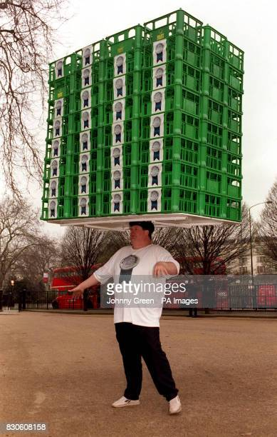 Strongman John Evans from Derbyshire as he smashes the world record of milk crate balancing in Hyde Park London Mr Evans balanced 96 crates on his...