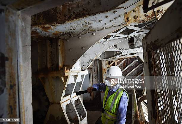 Structural engineer with the Federal Highway Administration George Choubah leads a tour inside the Arlington Memorial Bridge on Monday June 01 2015...