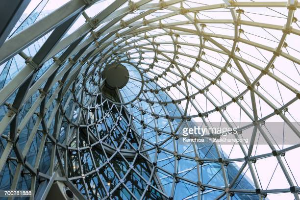 Structural glass facade curving roof of fantastic office building at the center of bangkok's building