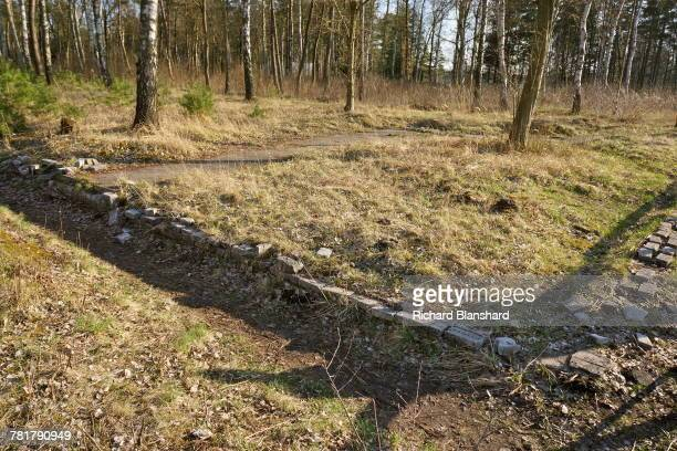 Structural remains at the site of the former BergenBelsen German Nazi concentration camp in Lower Saxony Germany 2014 Some of the bricks bear names...
