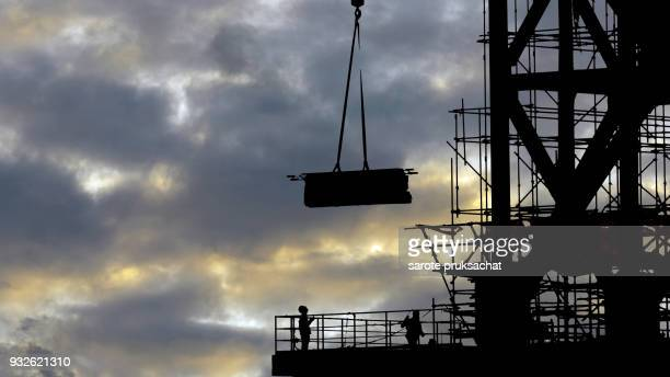 structural steel beam build large residential buildings at construction site .