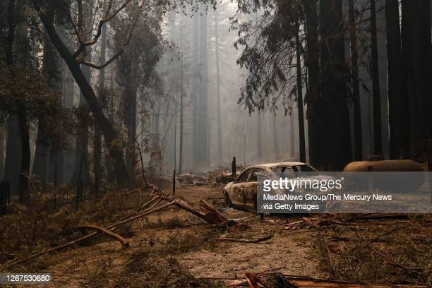 Structure and car near the Big Basin Redwoods State Park Headquarters & Visitor Center is burned down in Boulder Creek, Calif., on Thursday, Aug. 20,...