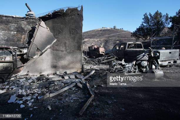 A structure and vehicle stand scorched by the Tick Fire on October 25 2019 in Canyon Country California The fire has blackened 4300 acres thus far...