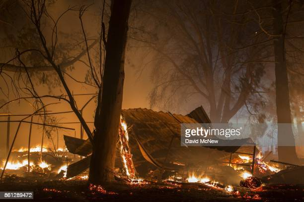 A structure burns in the early morning hours on October 14 2017 in Sonoma California At least 32 people are confirmed dead with hundreds still...