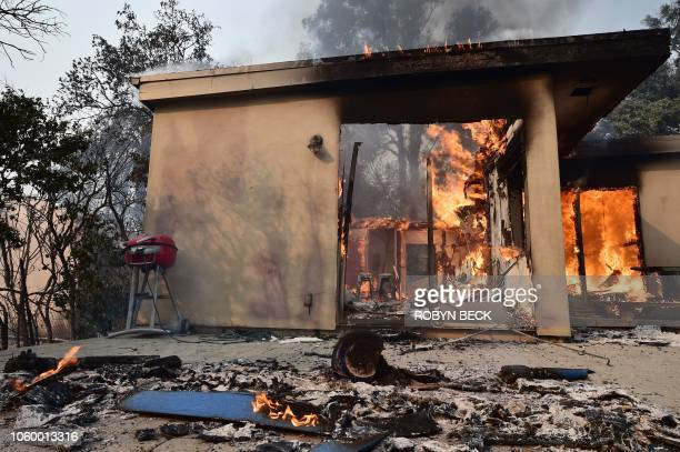 A structure burns in the Point Dume neighborhood of Malibu California on November 10 2018 after the Woolsey Fire tore through the neighborhood...