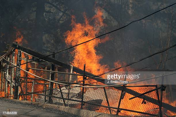 A structure burns October 23 2007 in Running Springs California Over 350000 people have been evacuated and hundreds of homes destroyed as wildfires...