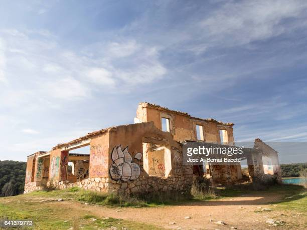 Structure of a abandoned building and in ruins on the top of a hill