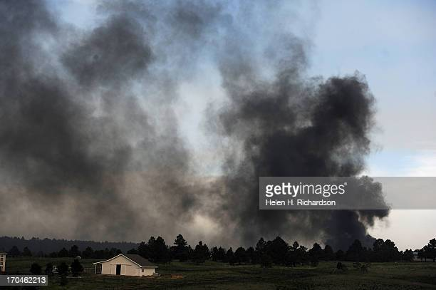 A structure of some sort burns on the horizon near Black Forest Road in the midst of the Black Forest Fire on June 12 2013 Photo by Helen H...