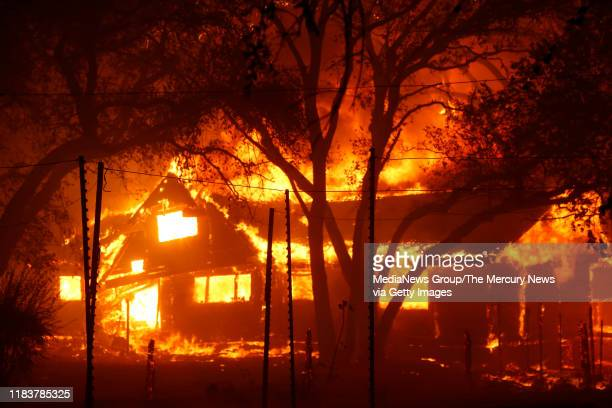 A structure on Highway 128 goes up in flames after the Kincade Fire raged into the Alexander Valley Sunday morning Oct 27 east of Geyserville Calif