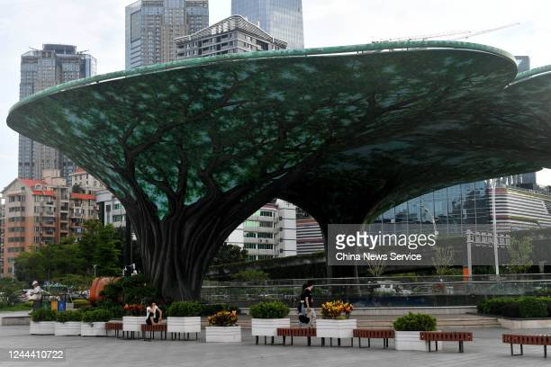 A structure painted like banyan trees which brings a sense of coolness to people in the hot summer is pictured at a commercial street on June 3 2020...