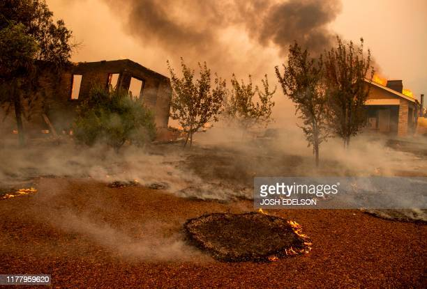 Structures burn at a vineyard during the Kincade fire near Geyserville California on October 24 2019 fastmoving wildfire roared through California...