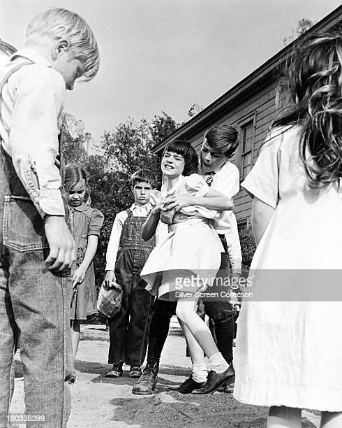 A struggle takes place between Jem and Scout Finch in a 'To Kill A Mockingbird' directed by Robert Mulligan 1962