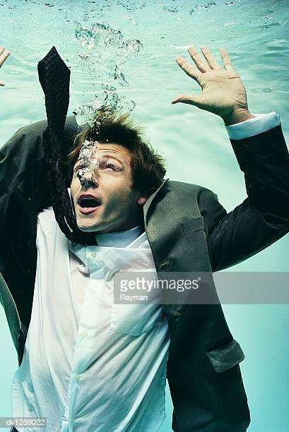 Struggling Businessman Underwater