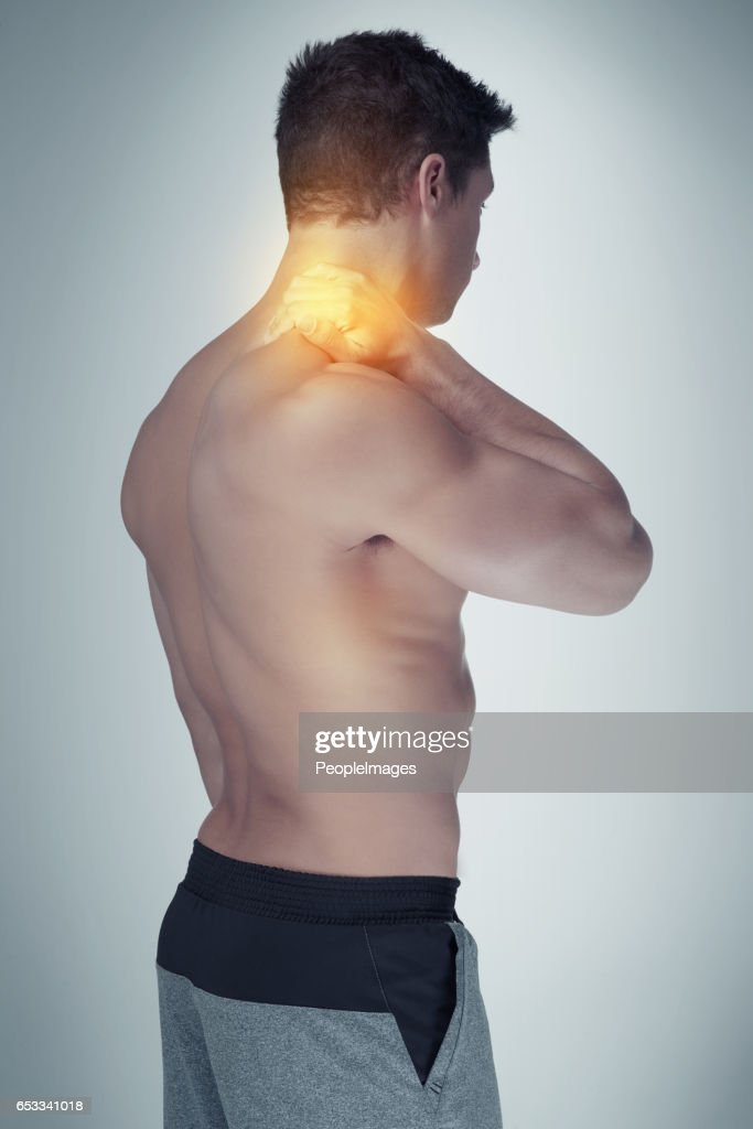 Struggling with a stiff and sore neck : Stock Photo