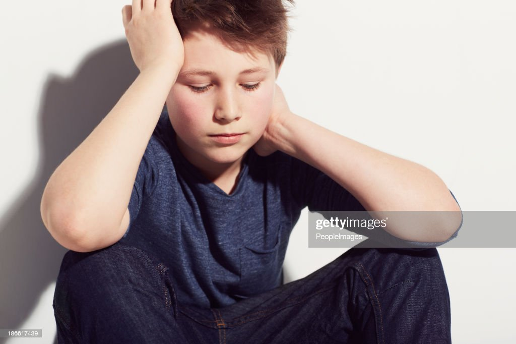 Struggling with childhood depression : Stock Photo