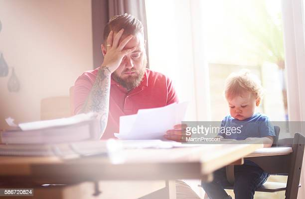 struggling with debt - defeat stock photos and pictures