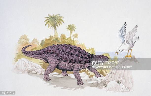 Struthiosaurus dinosaur confronting a bird
