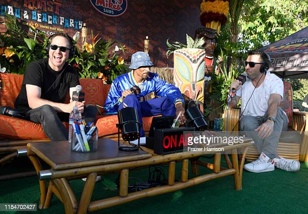 Stryker DJ Snoopadelic and Klein attend KROQ Weenie Roast Luau at Doheny State Beach on June 08 2019 in Dana Point California