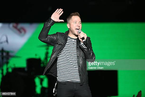 Stryker speaks onstage during day one of the 25th annual KROQ Almost Acoustic Christmas at The Forum on December 13 2014 in Inglewood California