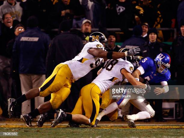 Stryker Sulak of the Missouri Tigers sacks quarterback Todd Reesing of the Kansas Jayhawks in the end zone for a safety during the final minute of...