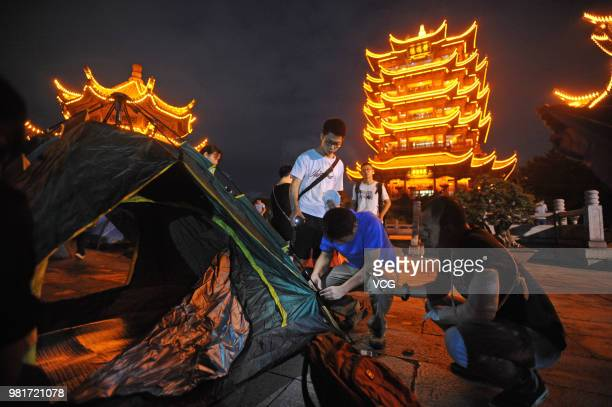 20 students who have finished their Senior High School Entrance Examination have a sleepover with their parents in tents at Yellow Crane Tower scenic...