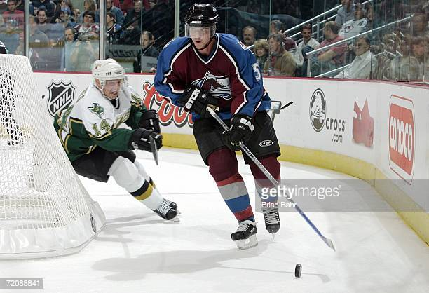 Stu Barnes of the Dallas Stars chases Brett Clark of the Colorado Avalanche as he takes the puck behind his own goal during the second period on...