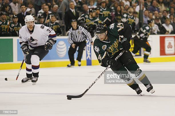 Stu Barnes of the Dallas Stars skates with the puck against the Vancouver Canucks during game three of the 2007 NHL Western Conference Quarterfinals...